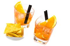 Top of view of two glasses of spritz aperitif aperol cocktail with orange slices and ice cubes near tacos chips Royalty Free Stock Images