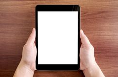 Top view of two hand holding tablet with blank white screen on d royalty free stock photos