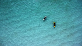 Top view two paddleboard on a sunny day. Aerial view of sup boards on the sea. Top view two paddleboard on a sunny day. View from above royalty free stock photography
