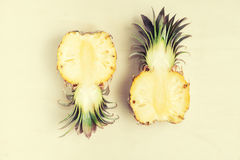 Top view of two pineapple halves on woden table. Vegetarian food ingredients. Detox. Text space royalty free stock images