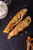 Top view on two portions of apple strudel on slate stone Royalty Free Stock Photos