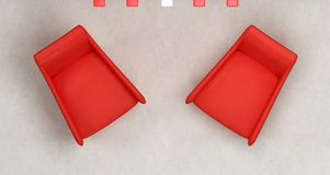 Top-view of two red armchair. With neon lamp on concrete background Royalty Free Stock Image