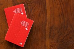 Two Swiss Passports on a wooden table stock photo