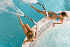 Top view - two woman relax in swimming pool. Sitting at bubble bath Stock Image