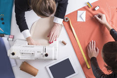 Top view of two women sewing. Royalty Free Stock Photography
