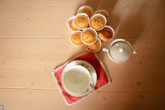 Top view of Breakfast set with some muffins. Top view of typical italian breakfast set with cup of milk and cup of sugar and muffins royalty free stock image