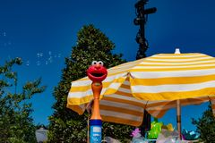 Top view of umbrella and bubbles coming out of Elmo toy at Seaworld in International Drive area 1. Orlando, Florida. April 20, 2019. Top view of umbrella and royalty free stock images