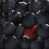Top view umbrellas society background. Red in mass of black. Sta Royalty Free Stock Photo