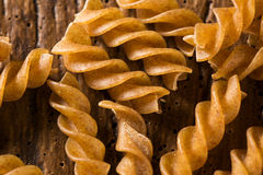 Top view of uncooked pasta integral on a wooden background Stock Photography