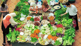 Vegetable stall sellers and buyers. Stock Photography