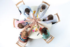 Top view. United hands of business team on workspace background Royalty Free Stock Photos