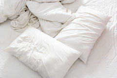 Top view of an unmade bed in a bedroom with crumpled bed sheet, Royalty Free Stock Photo