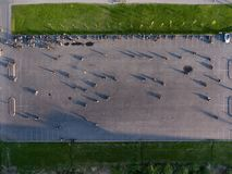 Top view at urban square with motorcyclists riding through cones during gymkhana training Royalty Free Stock Photos