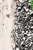 Top view of used asphalt stones on side of road Stock Photo