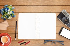 Top view of a used office desk with blank notepad Stock Photos