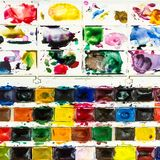 top view of used watercolor paints with pallet stock images