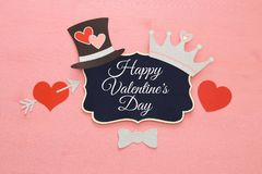 Top view Valentine& x27;s day background with funny photo booths props: gentleman hat, mustache, heart with arrow and crown. Top view Valentine& x27;s day Royalty Free Stock Photography