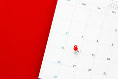 Top view valentine`s day the red pin mark at calendar. Royalty Free Stock Photography