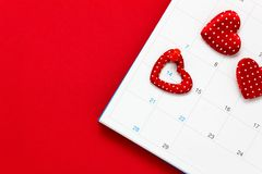 Top view valentines day background.the red pin mark February 14. At calendar on red background and heart  shape with copy space Royalty Free Stock Photography