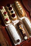 Top view of variety of eclairs royalty free stock photos