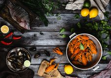 Various delicious seafood on rustic wooden table. Top view of various delicious seafood on rustic wooden table Royalty Free Stock Image