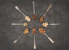 Assorted nuts in spoons Royalty Free Stock Images