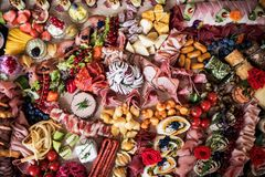 A top view of various food and snacks on a tray on a indoor party, a cold buffet. A top view of various food and snacks on a big tray on a indoor party, a cold royalty free stock images