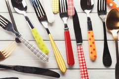 Collection of modern and antique cutlery, top view. Top view on various forks, knives and spoons. Set of assorted cutlery with fancy handles, flat lay on white Stock Photo