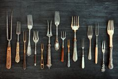 Top view on various forks, old utensils. Flat lay on rustic  dar Royalty Free Stock Image