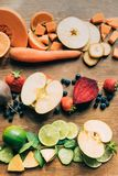 Top view of various fresh raw fruits and vegetables. On table Royalty Free Stock Photo
