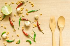 Top view of various fresh vegetables Paprika, peanut, garlic, lemon and herbs isolated on Wood background royalty free stock image