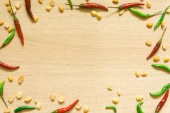 Top view of various fresh vegetables Paprika, peanut, garlic, lemon and herbs isolated on Wood background stock images