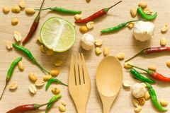 Top view of various fresh vegetables Paprika, peanut, garlic, lemon and herbs isolated on Wood background stock photography