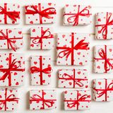 Top view of various gift boxes. wrapped valentine or other holiday handmade present in paper with red ribbon and heart. Present. Box, decoration of gift on stock images