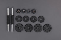 Top view of various metal barbells and weight plates Royalty Free Stock Photos