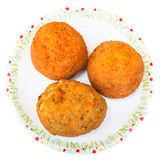 Top view of various rice balls arancini isolated. Traditional sicilian street food - top view of various rice balls arancini on plate isolated on white Stock Photography