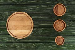 Top view of various types of wooden round cutting boards. On table royalty free stock images