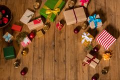 Christmas gifts background. Top view of various wrapped christmas gifts on wooden floor Stock Images