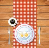 Heart-shaped fried eggs on white plate and coffee cup. Top view vector illustration of heart-shaped fried eggs on white plate and coffee cup with heart on wooden Stock Photos