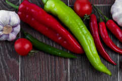 Top view of vegetables: chili and paprika pepper. Garlic, tomatoes Stock Photos