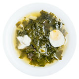 Top view of vegetarian soup in plate from greens. Top view of vegetarian soup in plate from fresh green leaves of spinach, sorrel, beet greens with half of egg royalty free stock image