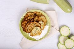 Top view of vegetarian zucchini pancakes on white wood background stock photo