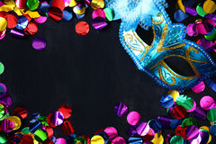 Top view of venetian masquerade mask and colorfull confetti. Royalty Free Stock Images