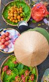 A top view of vietnam street hawker with displayed fruits and vegetables for sale. stock photos