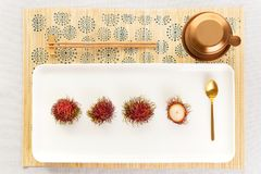 Top view of a Vietnamese coffee set up with rambutan in a light atmosphere royalty free stock photo