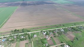 Top view of the village. One can see the roofs of the houses and gardens. Road in the village. Village bird`s-eye view. Top view of the village. One can see the stock video footage