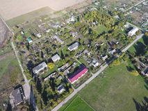 Top view of the village. One can see the roofs of the houses and gardens. Road in the village. Village bird's-eye view Stock Image