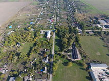 Top view of the village. One can see the roofs of the houses and gardens. Road in the village. Village bird's-eye view Royalty Free Stock Images