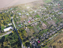 Top view of the village. One can see the roofs of the houses and gardens. Road in the village. Village bird's-eye view Royalty Free Stock Photography