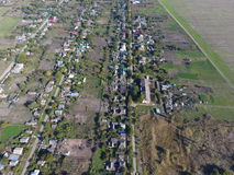 Top view of the village. One can see the roofs of the houses and gardens. Road in the village. Village bird's-eye view Stock Photos
